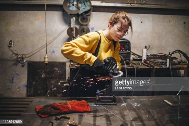 Young and confident metal working girl