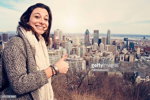"""young and happy travelling woman posing over cityscape. - """"martine doucet"""" or martinedoucet stock pictures, royalty-free photos & images"""