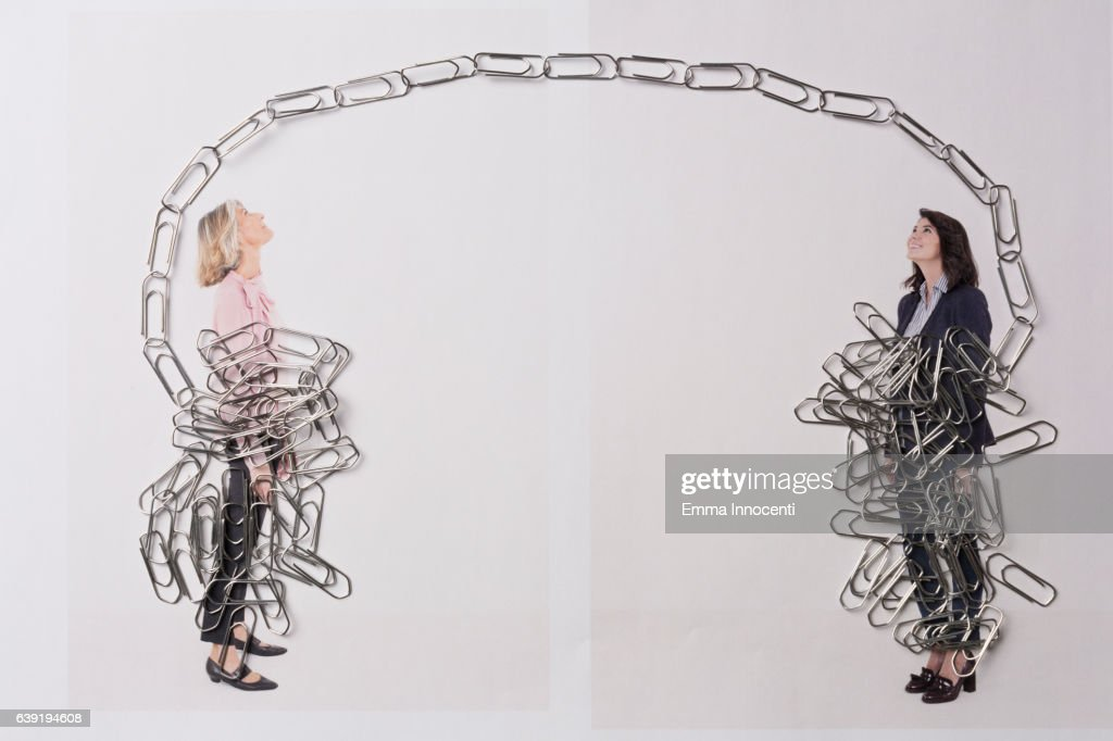 young and mature business women tied up stock photo | getty images