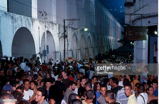 Young and multiethnic people enjoy nightlife at Lapa neighbourhood in Rio de Janeiro Brazil besides Arcos da Lapa an impressive aqueduct constructed...