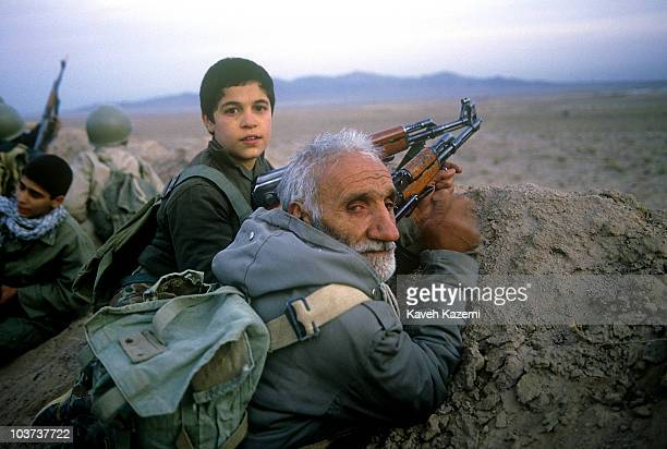 Young and old Basiji men participate in a military manoeuvre for the Iran-Iraq front in Robat-e-Karim outside Tehran, 19th November 1988.