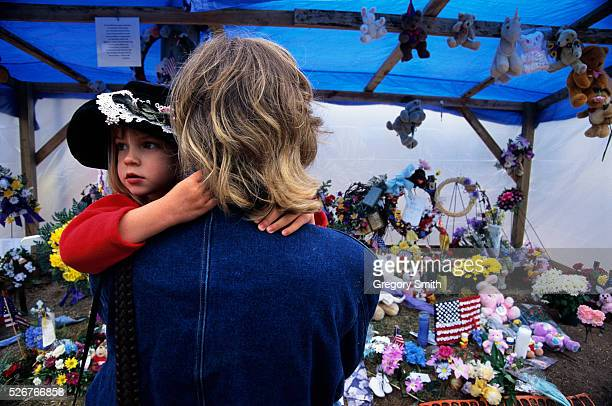 Young and old leave tributes to those who died in the bombing of the Alfred P Murrah Federal Building