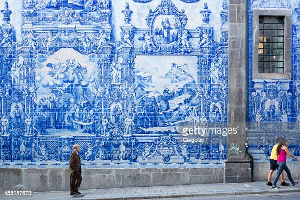 young and old people walking in a porto street - portuguese culture stock pictures, royalty-free photos & images