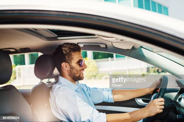 young and rich - driver stock pictures, royalty-free photos & images