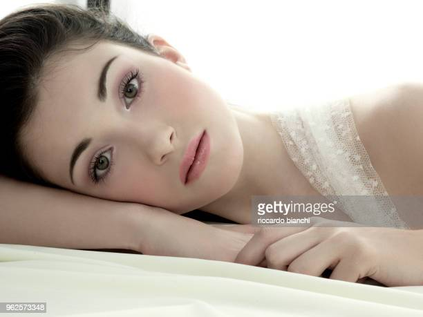 young and romantic woman lying on her side