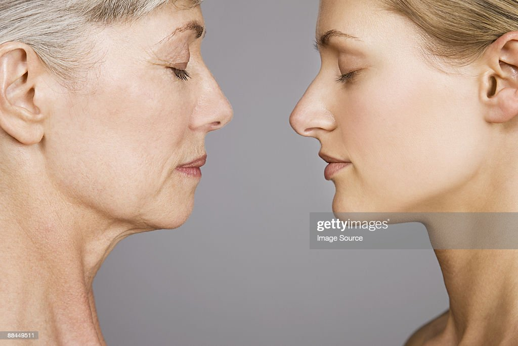 Young and senior women face to face : Stock Photo