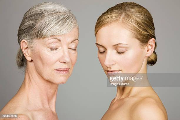 Young and senior women with eyes closed