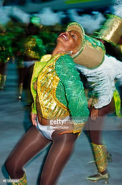 A young and sensual woman with nude breasts dancing at the Carnival Samba Schools Parade