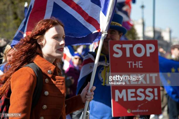 Young anti Brexit protester Florine Pochet from Lille in France shouts antiBrexit slogans and waves her flags opposite Parliament in Westminster as...