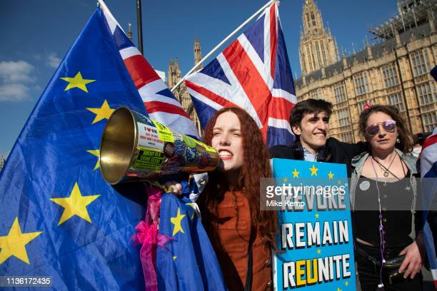Young anti Brexit protesters Shaun SmithMilne from Liverpool and Florine Pochet from Lille in France shout antiBrexit slogans and wave flags with...
