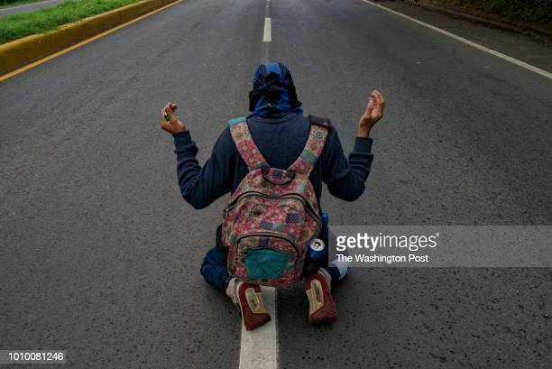 A young antiOrtega rebel prays in support of the city of Masaya which has been under attack by police and proOrtega paramilitary groups in Managua...