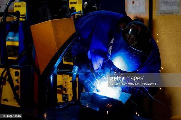 Young apprentice works during practical classes at the Essonne apprentice training center in Bondoufle, south of Paris on September 27, 2018.