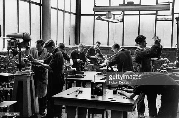Young apprentices learn a valuable trade at the Govan shipyards in Scotland.