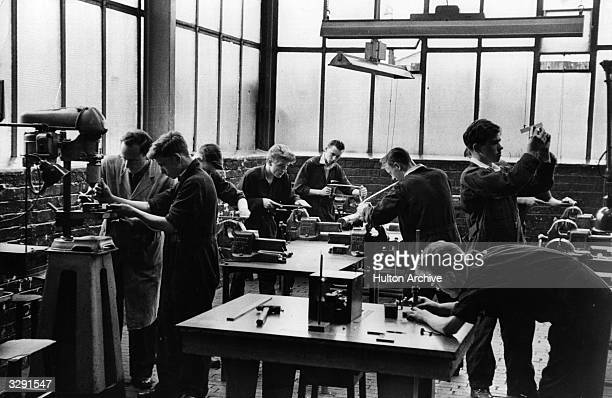 Young apprentices learn their trade at the Govan shipyard in Glasgow. The Clydeside shipyards were the biggest employers in the area and produced...