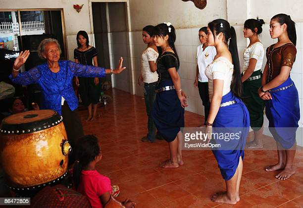 Young Apsara Dancer teached by a old lady SAKATHI a former Apsara Dancer in the Royal Family of King Sihanouk in Siem Reap on December 28 Cambodia