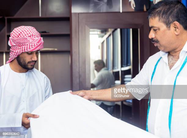 Young Arab admiring the quality of the fabric