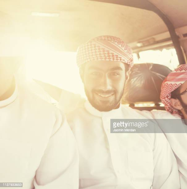 young arab friends travel vacation in car - bahrain national day stock photos and pictures