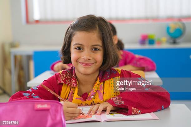 Young Arab girl in a school classroom. Dubai, United Arab Emirates