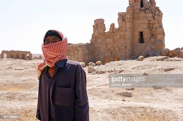 Young Arab shepherd, sheep in traditional Keffiyeh and Jalabiya, Syria