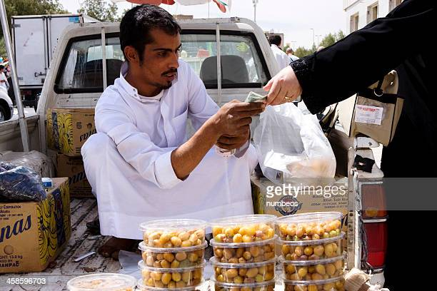 Young Arab vendor in traditional dress