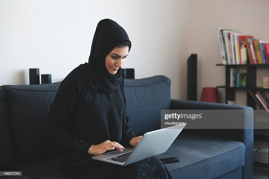 Young Arab Woman Doing Business Using Laptop : Stock Photo
