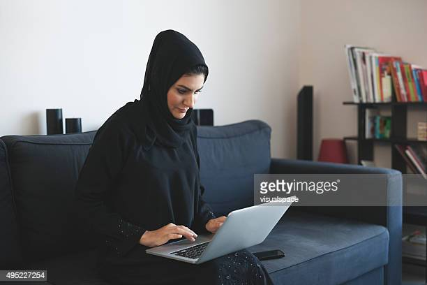 Young Arab Woman Doing Business Using Laptop