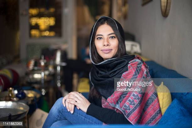 young arab woman in a bar - north africa stock pictures, royalty-free photos & images