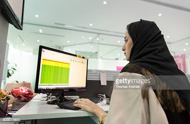 A young Arab woman sitting in front of a computer in the employment agency for women 'Glowork' on October 19 2015 in Riad Saudi Arabia