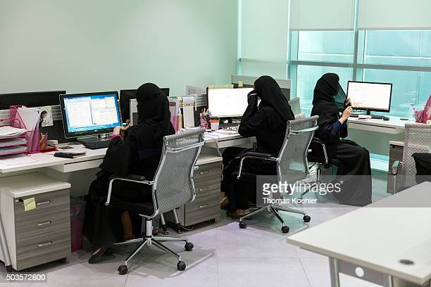 A young Arab women sitting in front of computers in the employment agency for women 'Glowork' on October 19 2015 in Riad Saudi Arabia