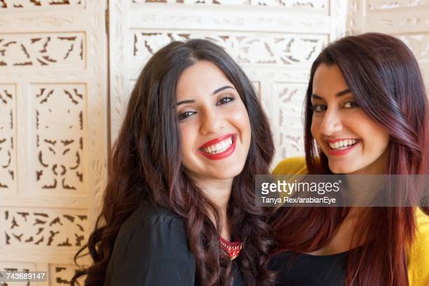 Young arab women smiling.