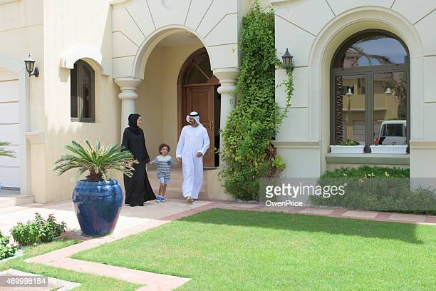 Young Arabic family leaving their luxury Dubai Villa