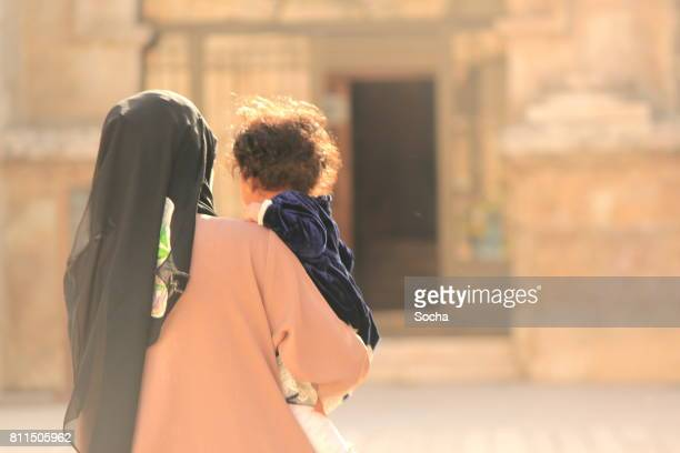 young arabic woman enjoying with her little daughter, amman, jordan - jordan love stock pictures, royalty-free photos & images