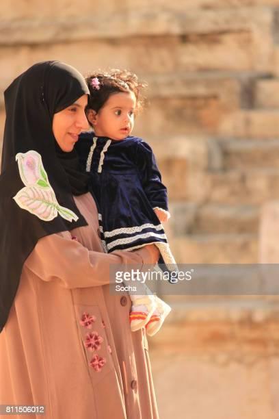 Young Arabic woman enjoying with her little daughter, Amman, Jordan