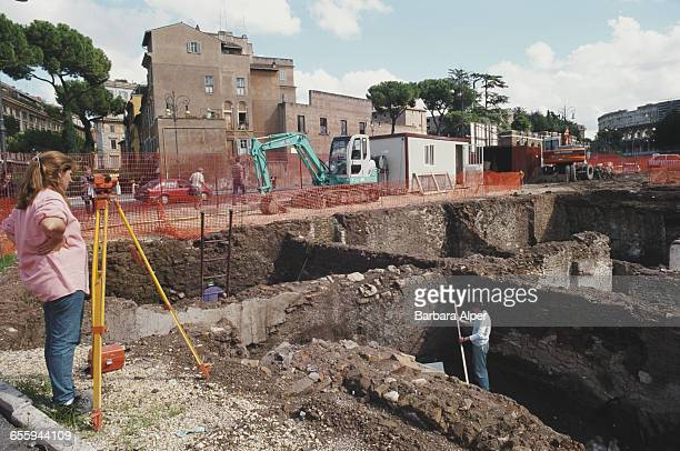 Young archaeologists working on the ancient Roman forum in Rome Italy October 1999