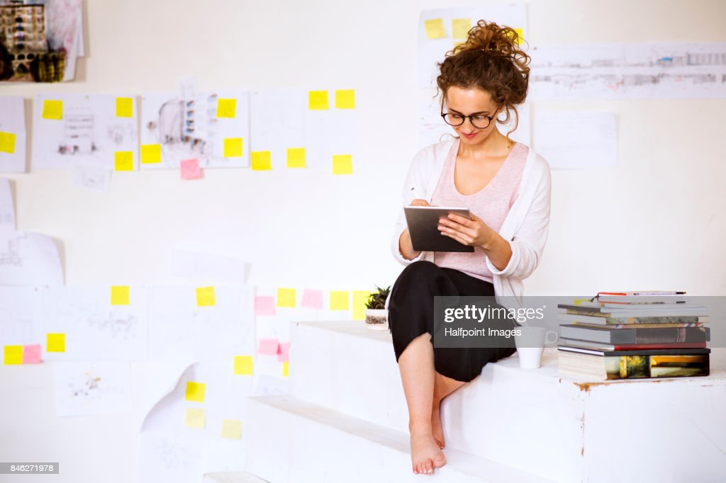 Young Architect Or Designer Working On Tablet. : Stock Photo
