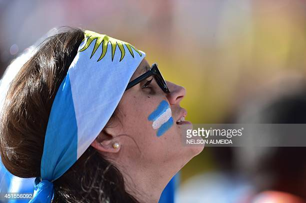 A young Argentia fan is pictured prior to a Round of 16 football match between Argentina and Switzerland at Corinthians Arena in Sao Paulo during the...
