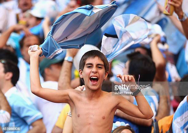 A young Argentina fan shows his support during the 2014 FIFA World Cup Brazil Quarter Final match between Argentina and Belgium at Estadio Nacional...