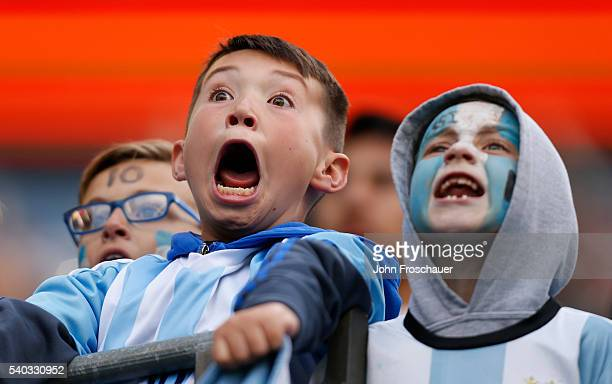 Young Argentina fans react in the stands as the team prepares to enter the field during a group D match between Argentina and Bolivia at CenturyLink...