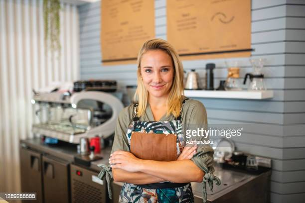 young argentine barista ready to prepare coffee drink - coffee drink stock pictures, royalty-free photos & images