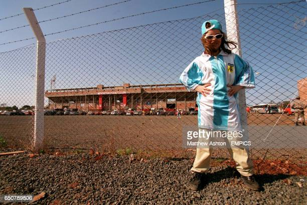 A young Argentinian fan stands outside the Estadio 3 de Fevereiro in Cuidad Del Este Paraguay before the Copa America Quarter Final Brazil v Argentina