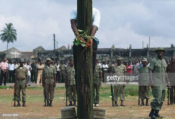 A young Armed Forces of Liberia soldier accused of looting and murder is bound to a telegraph pole before facing the firing squad A percentage of...