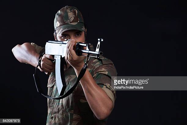 young army man aiming with a rifle - indian soldier stock photos and pictures