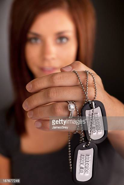 young army wife displays wedding ring and dog tags - military dog tags stock pictures, royalty-free photos & images