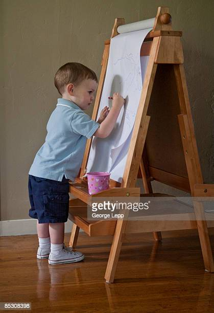 Young (2 years) artist at work