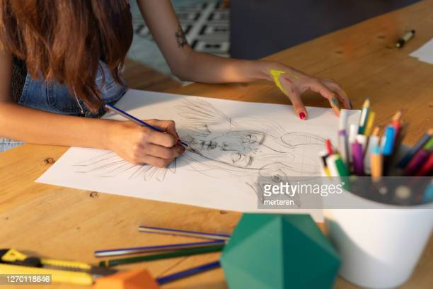 young artist drawing fantastic portrait - drawing artistic product stock pictures, royalty-free photos & images