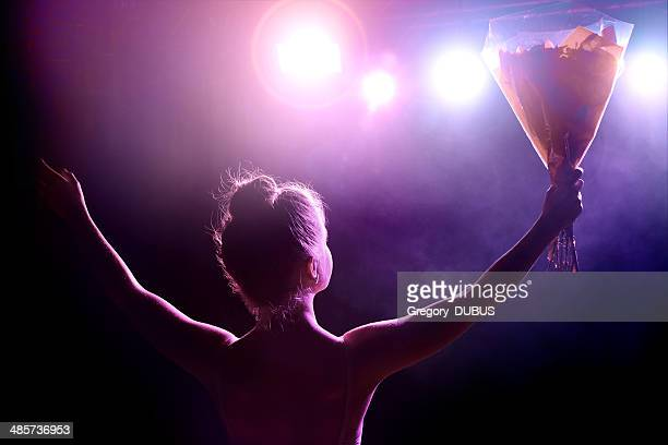 young artist girl greeting her public after performance on stage - backstage stock pictures, royalty-free photos & images