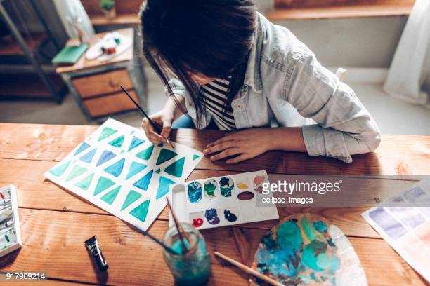 young artist learning how to draw shapes - acrylic painting stock pictures, royalty-free photos & images