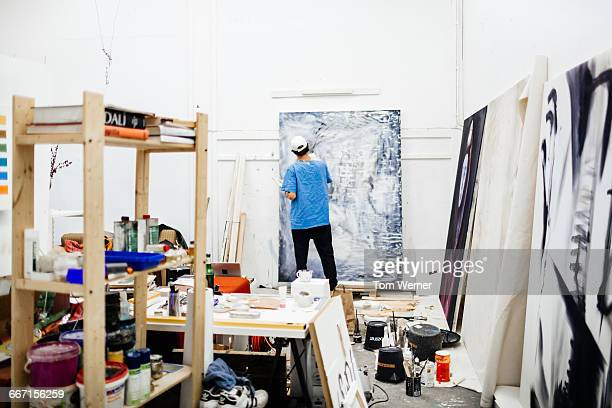Young artist working in his atelier