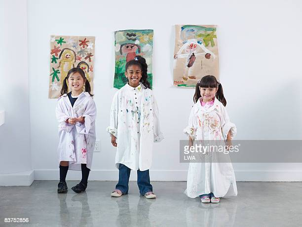 Young Artists in Front of Paintings