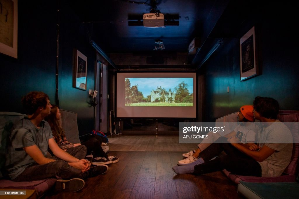 Young Artists Watch A Film In The Movie Theater Room At The Upart News Photo Getty Images